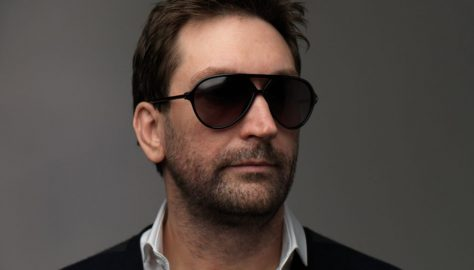 Leslie-Benzies-with-shadesfd